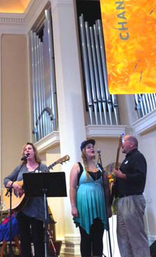 "Vickie Crebbin, Olivia Beattie and Greg Beattie singing ""I Choose Love"""